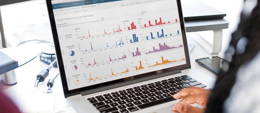 A person reviews a Tableau dashboard in a stock image photo.
